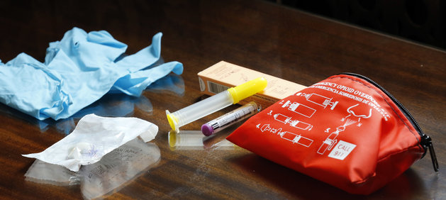 The contents of an emergency opioid overdose kit is seen at the statehouse Tuesday Sept. 29, 2015 in Concord, N.H. New Hampshire will begin handing out free kits of the opioid antidote naloxone this fall to families and friends of people at risk of an opioid overdose. (AP Photo/Jim Cole)