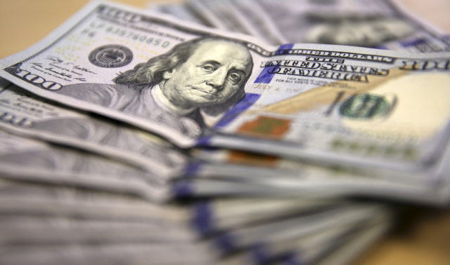 Photo illustration of U.S. dollar notes displayed in Johannesburg