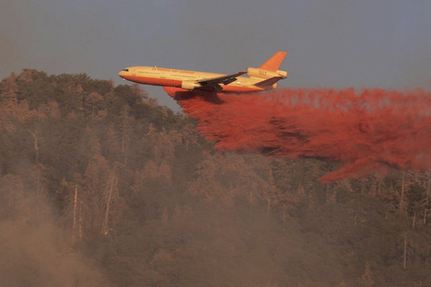 A fire fighting aircraft drops fire retardant over wildfire in Kern County in central California